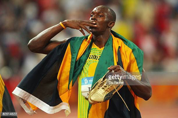 Usain Bolt of Jamaica celebrates after winning the Men's 4 x 100m Relay Final at the National Stadium on Day 14 of the Beijing 2008 Olympic Games on...