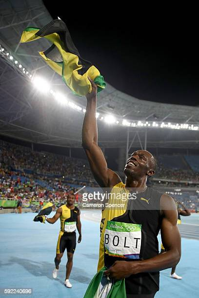 Usain Bolt of Jamaica celebrates after winning the Men's 4 x 100m Relay Final on Day 14 of the Rio 2016 Olympic Games at the Olympic Stadium on...