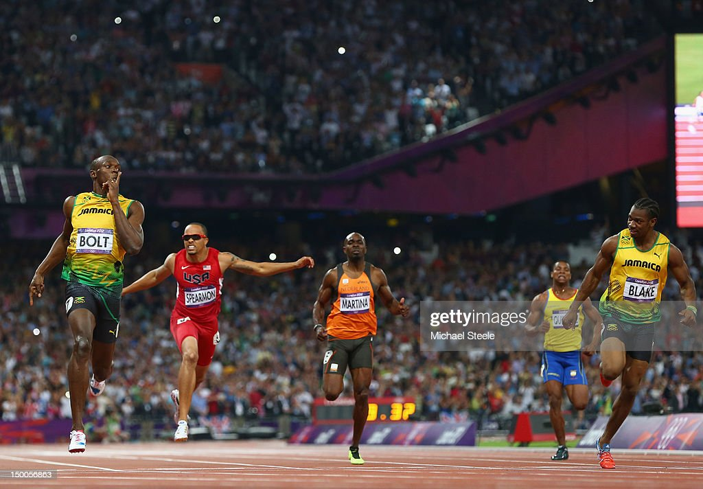 Usain Bolt of Jamaica celebrates as he crosses the finish line ahead of Wallace Spearmon of the United States, Churandy Martina of Netherlands, Yohan Blake of Jamaica and Alex Quinonez of Ecuador to win gold in the Men's 200m Final on Day 13 of the London 2012 Olympic Games at Olympic Stadium on August 9, 2012 in London, England.