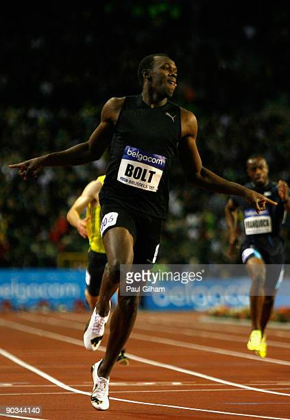 Usain Bolt of Jamaica celebrates as he crosses the finish line to take the victory in the Mens 200m during the IAAF Golden League Memorial Van Damme...