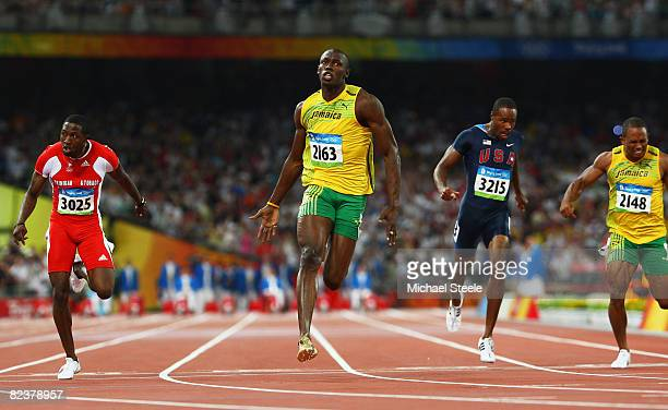 Usain Bolt of Jamaica celebrates as he crosses the line to win the Men's 100m Final at the National Stadium on Day 8 of the Beijing 2008 Olympic...