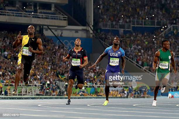 Usain Bolt of Jamaica celebrates as he wins the Mens 100m final ahead of Jimmy Vicaut of France Justin Gatlin of the United States and Akani Simbine...