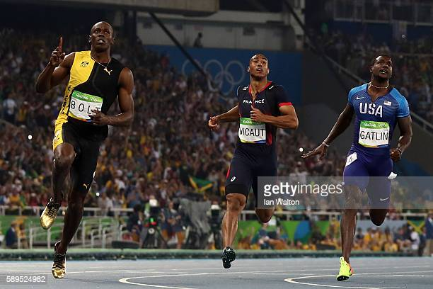 Usain Bolt of Jamaica celebrates as he wins the Mens 100m final ahead of Jimmy Vicaut of France and Justin Gatlin of the United States on Day 9 of...