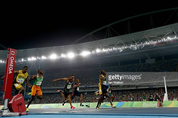 Usain Bolt of Jamaica celebrates as he wins the Mens 100m final on Day 9 of the Rio 2016 Olympic Games at the Olympic Stadium on August 14 2016 in...