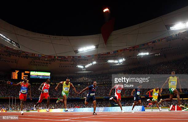 Usain Bolt of Jamaica celebrates crossing the line in the Men's 100m Final at the National Stadium on Day 8 of the Beijing 2008 Olympic Games on...
