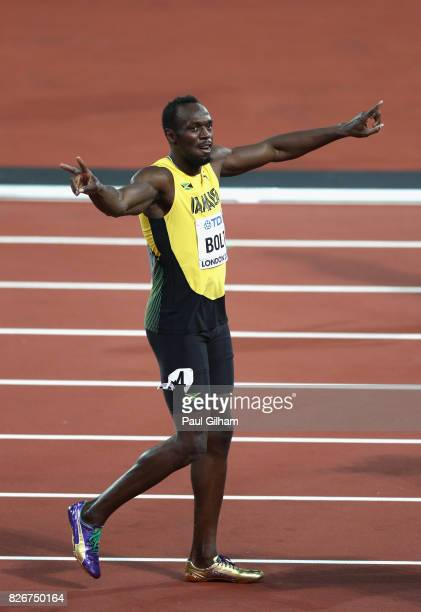 Usain Bolt of Jamaica celebrates during a lap of honour following finishing in third place in the mens 100m final during day two of the 16th IAAF...