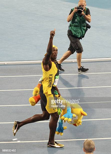 JANEIRO BRAZIL AUGUST Usain Bolt of Jamaica celebrates his victory after the Athletics men's100m under the camera of great photographer Franck Fife...