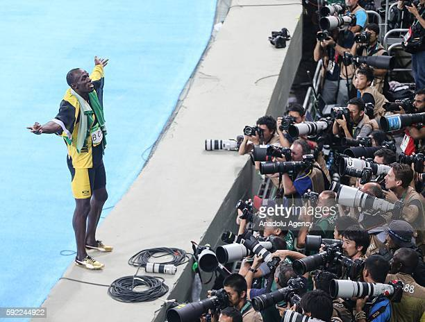 Usain Bolt of Jamaica celebrates victory after the Men's 4 x 100m Relay Final of the Rio 2016 Olympic Games at the Olympic Stadium in Rio de Janeiro,...