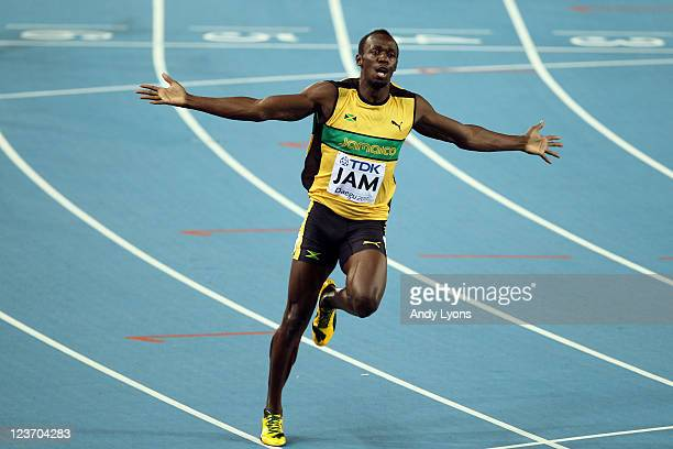 Usain Bolt of Jamaica celebrates victory and a new world record in the men's 4x100 metres relay final during day nine of 13th IAAF World Athletics...