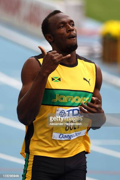Usain Bolt of Jamaica celebrates victory in the men's 200 metres heats during day seven of 13th IAAF World Athletics Championships at Daegu Stadium...