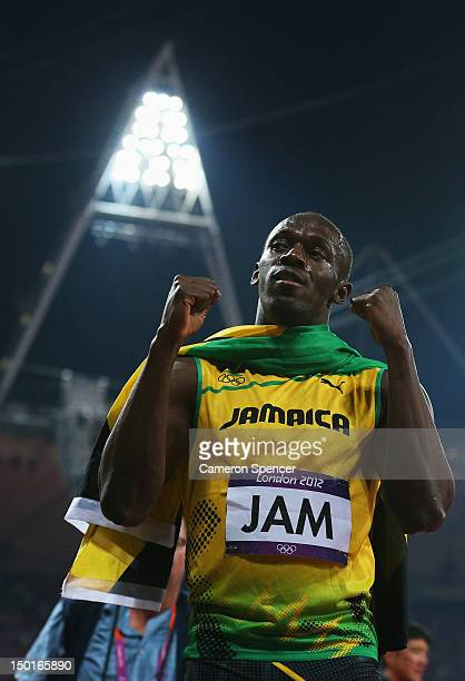 Usain Bolt of Jamaica celebrates winning gold and setting a new world record of 36.84 during the Men's 4 x 100m Relay Final on Day 15 of the London...