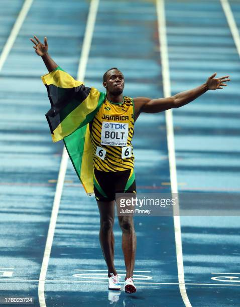 Usain Bolt of Jamaica celebrates winning gold in the Men's 100 metres Final during Day Two of the 14th IAAF World Athletics Championships Moscow 2013...