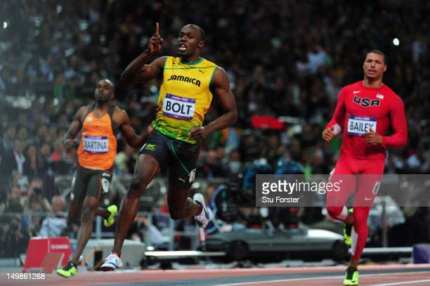 Usain Bolt of Jamaica celebrates winning gold in the Men's 100m Final on Day 9 of the London 2012 Olympic Games at the Olympic Stadium on August 5,...