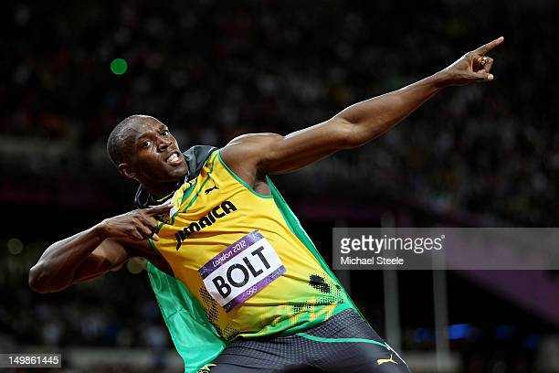 Usain Bolt of Jamaica celebrates winning gold in the Men's 100m Final on Day 9 of the London 2012 Olympic Games at the Olympic Stadium on August 5...