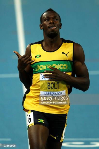 Usain Bolt of Jamaica celebrates winning his men's 200 metres semi final during day seven of 13th IAAF World Athletics Championships at Daegu Stadium...