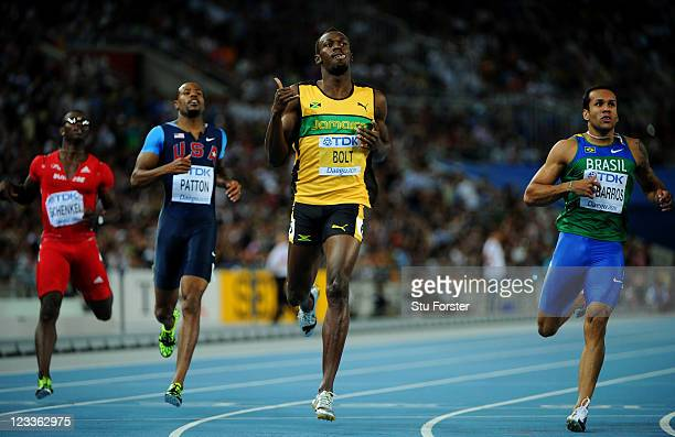 Usain Bolt of Jamaica celebrates winning his men's 200 metres semi final ahead of Bruno de Barros of Brazil during day seven of 13th IAAF World...