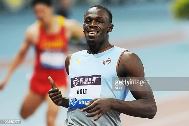 Usain Bolt of Jamaica celebrates winning the 200m during the IAAF Diamond League Shanghai at Shanghai Stadium on May 23 2010 in Shanghai China