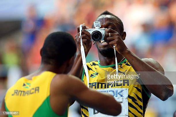Usain Bolt of Jamaica celebrates winning the gold medal in the Men's 200 metres final during Day Eight of the 14th IAAF World Athletics Championships...