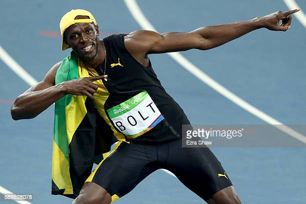 Usain Bolt of Jamaica celebrates winning the Men's 100 meter final on Day 9 of the Rio 2016 Olympic Games at the Olympic Stadium on August 14 2016 in...