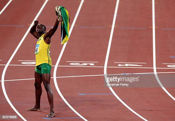 Usain Bolt of Jamaica celebrates winning the Men's 100m Final and the gold medal at the National Stadium on Day 8 of the Beijing 2008 Olympic Games...