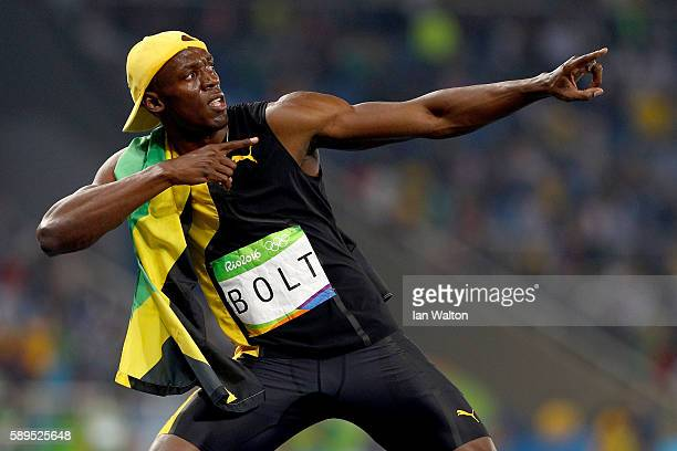 Usain Bolt of Jamaica celebrates winning the Men's 100m Final on Day 9 of the Rio 2016 Olympic Games at the Olympic Stadium on August 14 2016 in Rio...