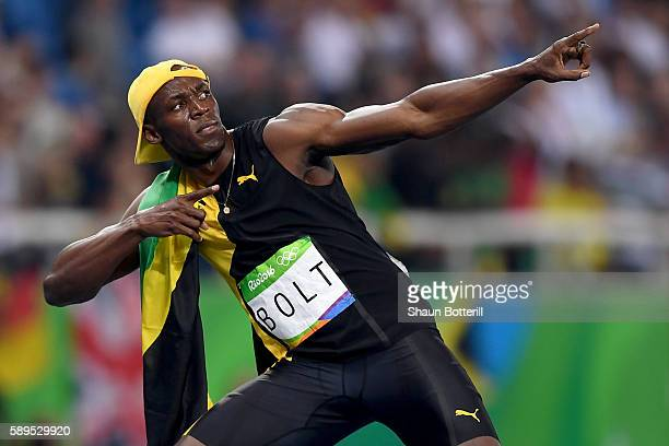 Usain Bolt of Jamaica celebrates winning the Men's 100m Final on Day 9 of the Rio 2016 Olympic Games at the Olympic Stadium on August 14, 2016 in Rio...