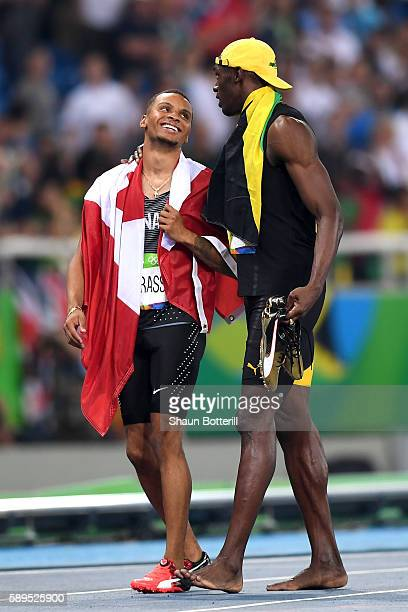 Usain Bolt of Jamaica celebrates winning the Men's 100m Final with third place finisher Andre De Grasse of Canada on Day 9 of the Rio 2016 Olympic...