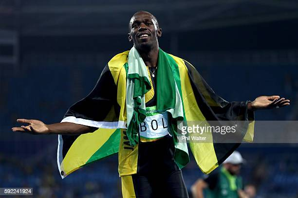 Usain Bolt of Jamaica celebrates winning the Men's 4 x 100m Relay Final on Day 14 of the Rio 2016 Olympic Games at the Olympic Stadium on August 19...