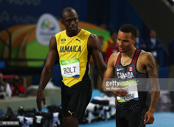 Usain Bolt of Jamaica celebrates winning with silver medalist Andre de Grasse of Canada after the Men's 200m Final on Day 13 of the Rio 2016 Olympic...