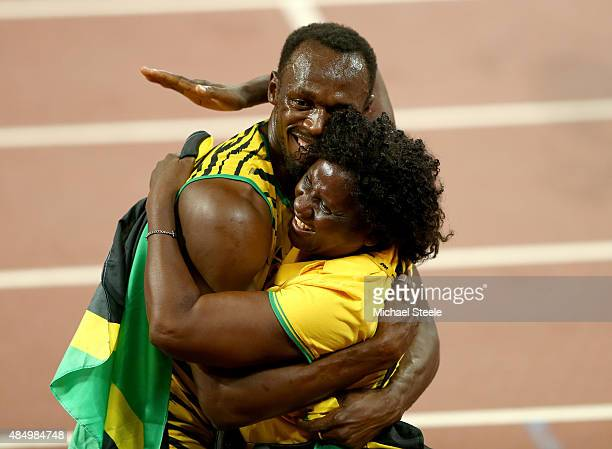 Usain Bolt of Jamaica celebrates with mother Jennifer Bolt after winning gold in the Men's 100 metres final during day two of the 15th IAAF World...