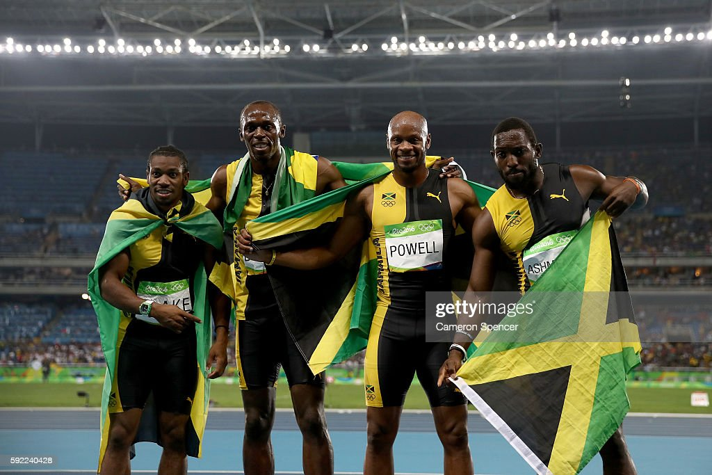 Usain Bolt of Jamaica celebrates with teammates Asafa Powell, Yohan Blake and Nickel Ashmeade after winning the Men's 4 x 100m Relay Final on Day 14 of the Rio 2016 Olympic Games at the Olympic Stadium on August 19, 2016 in Rio de Janeiro, Brazil.
