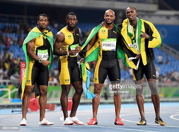 Usain Bolt of Jamaica celebrates with teammates Asafa Powell, Yohan Blake and Nickel Ashmeade after they won the Men's 4 x 100m Relay Final on Day 14...