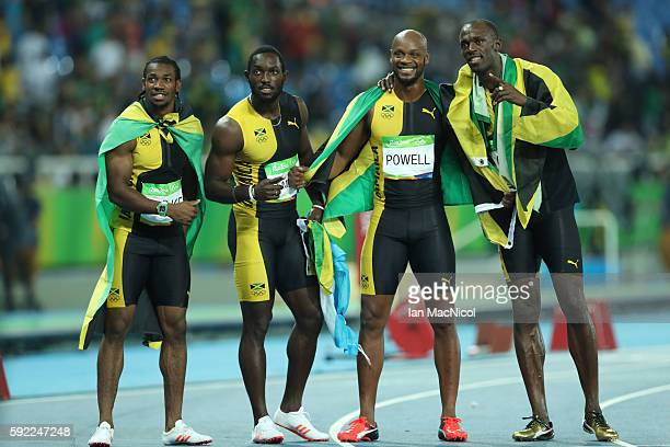 Usain Bolt of Jamaica celebrates with teammates Asafa Powell, Yohan Blake and Nickel Ashmeade after winning the Men's 4 x 100m Relay Final on Day 14...