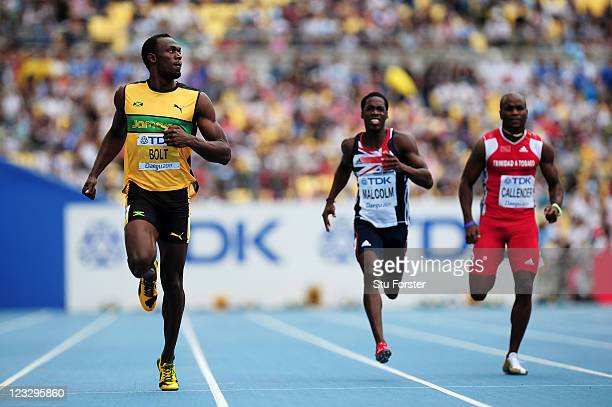 Usain Bolt of Jamaica claims victory in the men's 200 metres heats during day seven of 13th IAAF World Athletics Championships at Daegu Stadium on...