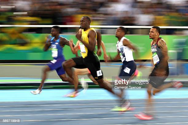 Usain Bolt of Jamaica competes in the Men's 100 meter semifinal on Day 9 of the Rio 2016 Olympic Games at the Olympic Stadium on August 14, 2016 in...