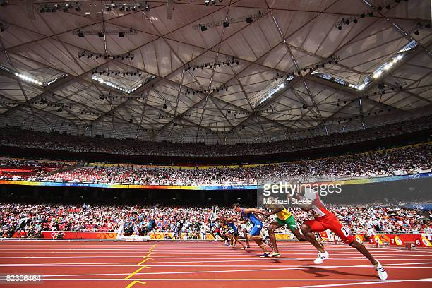 Usain Bolt of Jamaica competes in the Men's 100m Heats at the National Stadium on Day 7 of the Beijing 2008 Olympic Games on August 15, 2008 in...