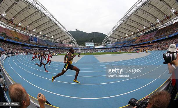 Usain Bolt of Jamaica competes in the men's 200 metres heats during day seven of 13th IAAF World Athletics Championships at Daegu Stadium on...