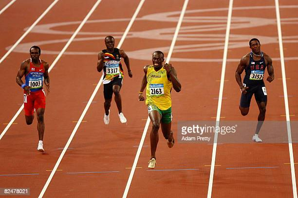 Usain Bolt of Jamaica competes on his way to breaking the world record with a time of 1930 to win the gold medal in the Men's 200m Final ahead of...