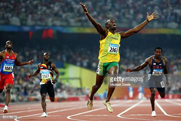 Usain Bolt of Jamaica competes on his way to breaking the world record with a time of 19.30 to win the gold medal in the Men's 200m Final ahead of...
