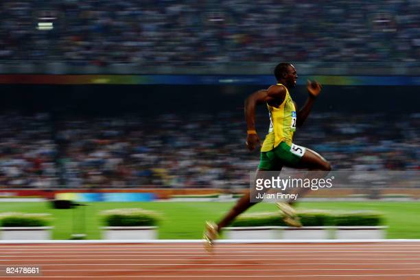 Usain Bolt of Jamaica competes on his way to breaking the world record with a time of 1930 to win the gold medal in the Men's 200m Final at the...