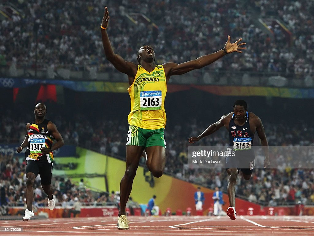 Usain Bolt of Jamaica competes on his way to breaking the world record with a time of 19.30 to win the gold medal in the Men's 200m Final against Kim Collins of Saint Kitts and Nevis, Christian Malcolm of Great Britain, Shawn Crawford of the United States, Churandy Martina of Netherlands Antilles, Brian Dzingai of Zimbabwe and at the National Stadium during Day 12 of the Beijing 2008 Olympic Games on August 20, 2008 in Beijing, China.