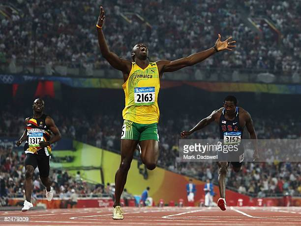 Usain Bolt of Jamaica competes on his way to breaking the world record with a time of 1930 to win the gold medal in the Men's 200m Final against Kim...