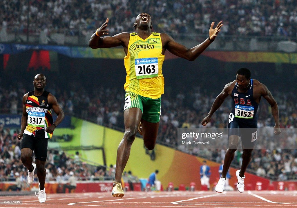 Usain Bolt of Jamaica competes on his way to breaking the world record with a time of 19.30 to win the gold medal in the Men's 200m Final against Kim Collins of Saint Kitts and Nevis and Shawn Crawford of the United States of America at the National Stadium during Day 12 of the Beijing 2008 Olympic Games on August 20, 2008 in Beijing, China.