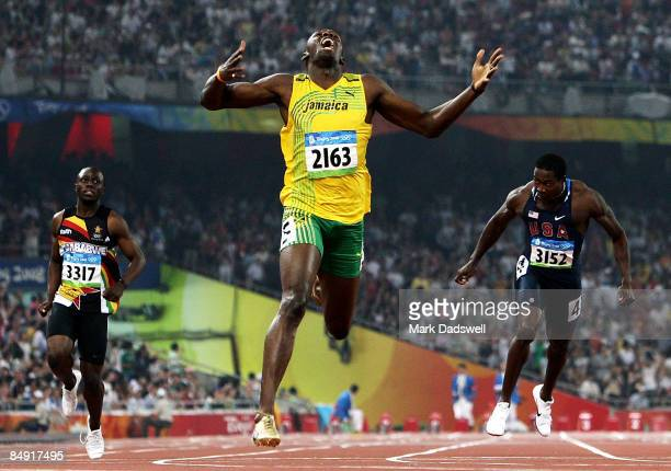 Usain Bolt of Jamaica competes on his way to breaking the world record with a time of 19.30 to win the gold medal in the Men's 200m Final against Kim...