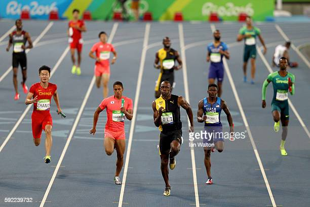 Usain Bolt of Jamaica competes on his way to winning ahead of Aska Cambridge of Japan and Trayvon Bromell of the United States in the Men's 4 x 100m...