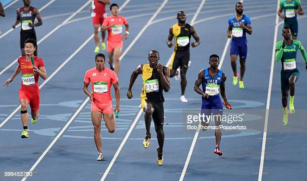 Usain Bolt of Jamaica competes on his way to winning ahead of Aska Cambridge of Japan and Trayvon Bromell of the United States during the Men's 4 x...