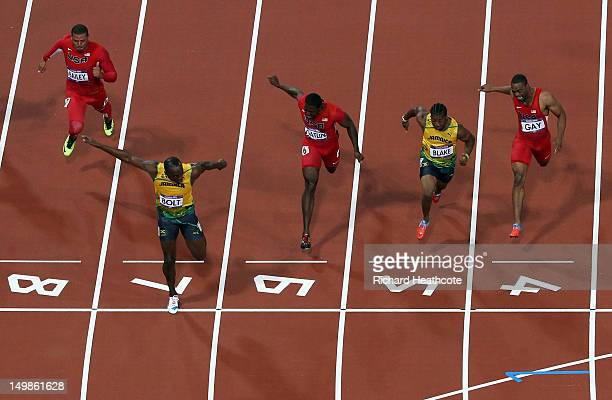 Usain Bolt of Jamaica crosses the finish line ahead of Ryan Bailey of the United States Yohan Blake of Jamaica and Justin Gatlin of the United States...