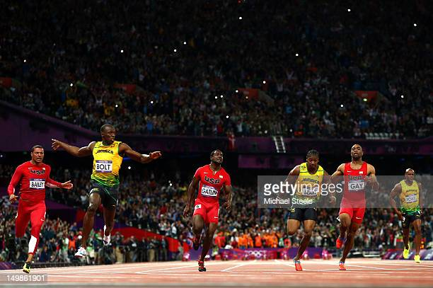 Usain Bolt of Jamaica crosses the finish line ahead of Ryan Bailey of the United States, Yohan Blake of Jamaica and Justin Gatlin of the United...