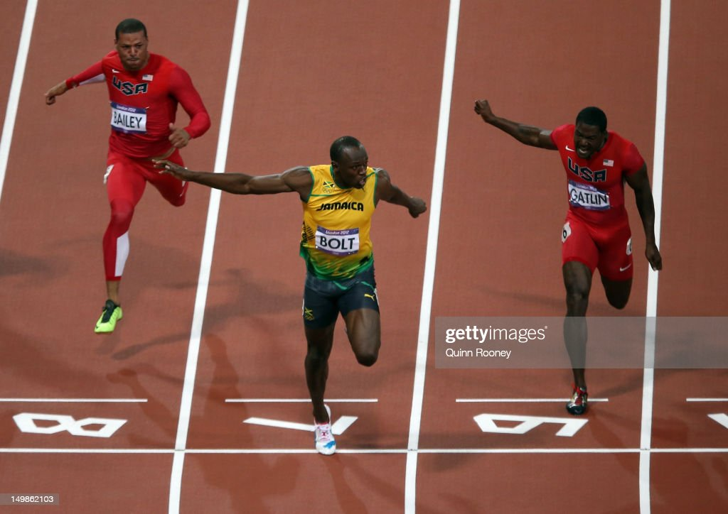 Usain Bolt of Jamaica crosses the finish line ahead of Ryan Bailey of the United States and Justin Gatlin of the United States to win the Men's 100m Final on Day 9 of the London 2012 Olympic Games at the Olympic Stadium on August 5, 2012 in London, England.