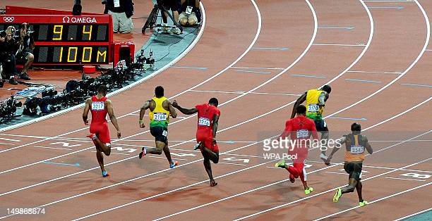 Usain Bolt of Jamaica crosses the finish line ahead of Tyson Gay of the United States Yohan Blake of Jamaica Justin Gatlin of the United States Ryan...